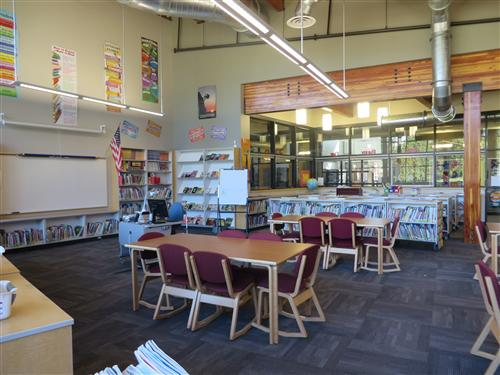Picture of library with tables and shelves