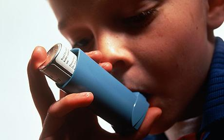 Kid using an inhaler