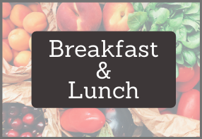 Fruit and vegetable background with Breakfast and Lunch title in white text