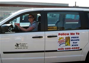 Everett public Schools van with Follow Me to Free Meals sign on it