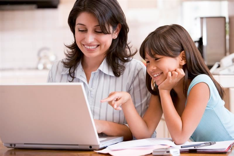 student with parent on laptop