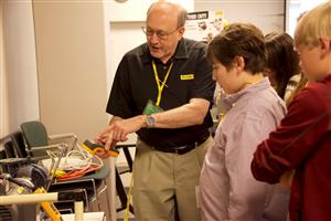 Staff helping students with energy equipment